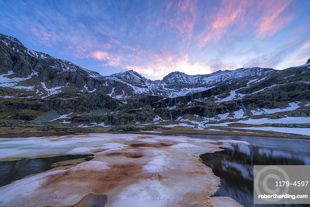 Melting ice during thaw at dawn, Alpe Fora, Valmalenco, Sondrio province, Valtellina, Lombardy, Italy