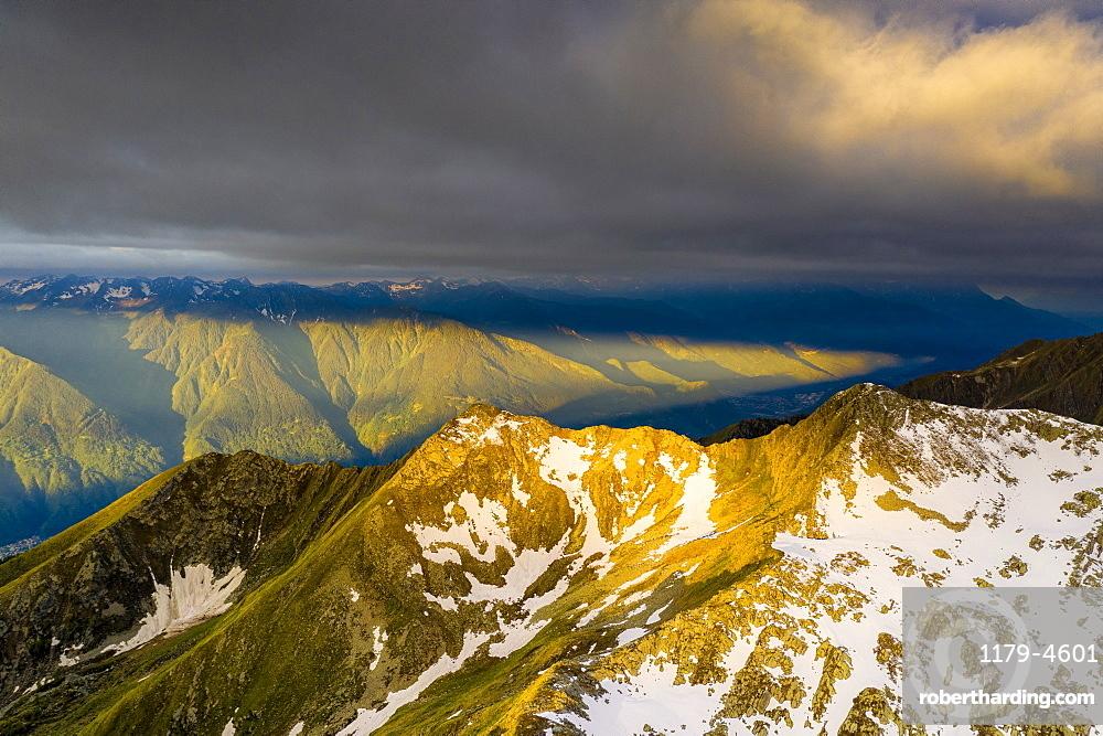 Sunrise over Orobie Alps from Sasso Bianco, aerial view, Valmalenco, Sondrio province, Valtellina, Lombardy, Italy
