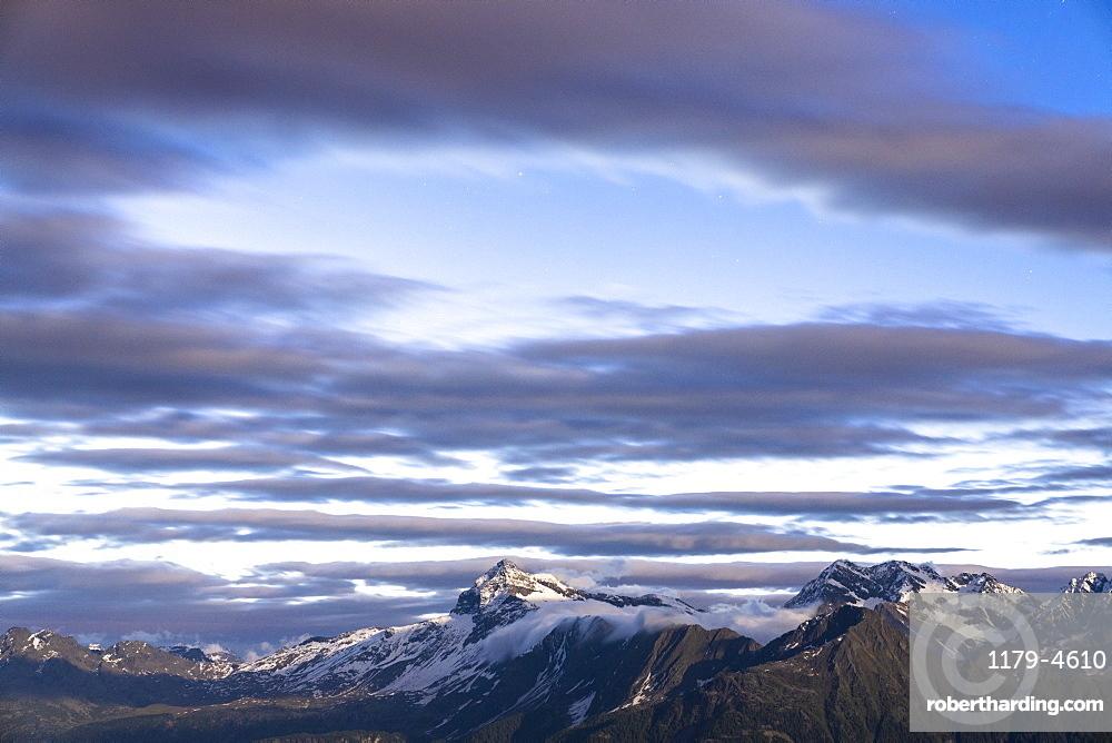 Aerial view of Pizzo Scalino mountain peak during sunrise, Valmalenco, Sondrio province, Valtellina, Lombardy, Italy