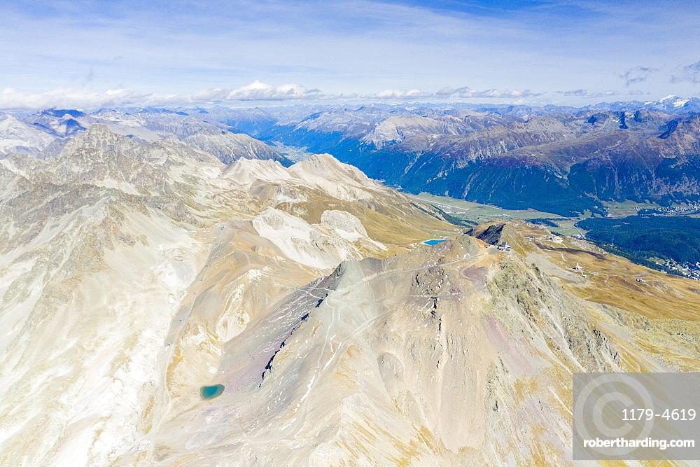 Aerial panoramic of majestic Piz Nair mountain and lake Lej Da La Pesch, Engadine, canton of Graubunden, Switzerland (drone)