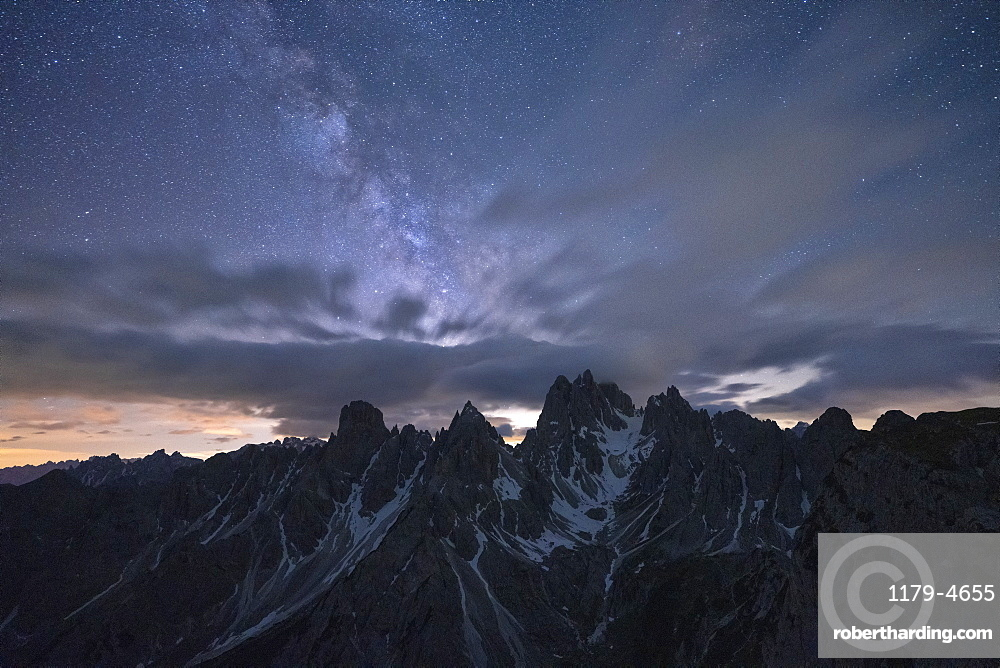 Milky Way and stars over the sharp pinnacles of Cadini di Misurina, Dolomites, Belluno province, Veneto, Italy, Europe