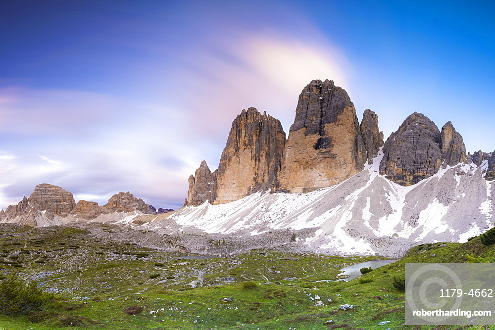 Sunset over Tre Cime di Lavaredo, Monte Paterno and Grava Longa lakes in summer, Sesto Dolomites Natural Park, South Tyrol, Italy, Europe