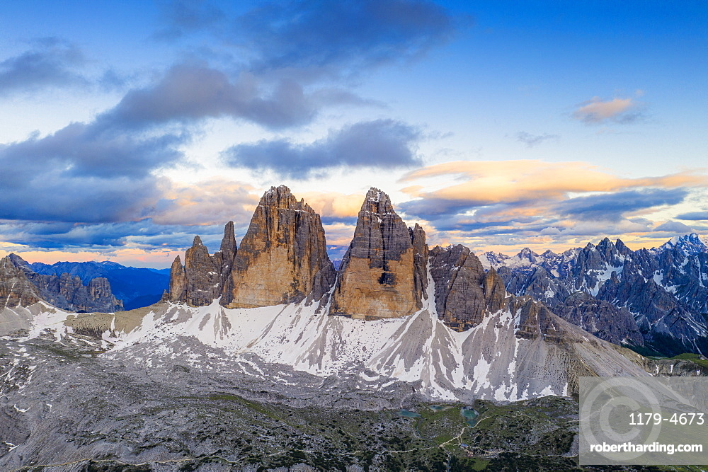Aerial view of Tre Cime di Lavaredo and Grava Longa lakes at sunset, Sesto Dolomites Natural Park, South Tyrol, Italy, Europe