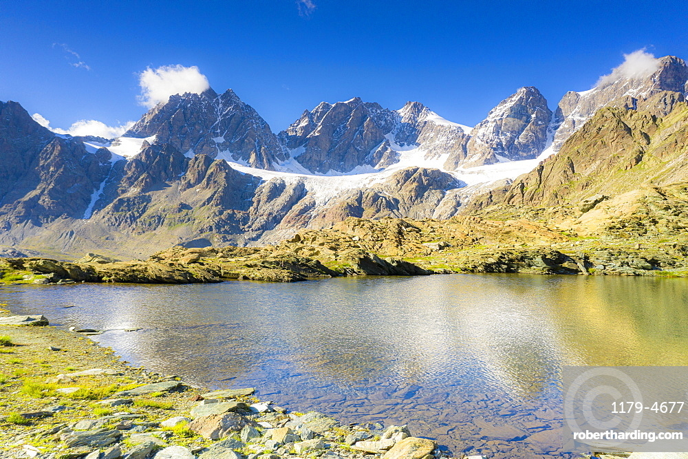 Clear sky over the rocky peaks of Bernina Group and Forbici lake in summer, Valmalenco, Valtellina, Lombardy, Italy, Europe