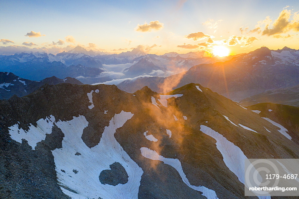 Last rays of sunset light the rocky mountain peaks, Furka Pass, Canton Uri, Switzerland, Europe