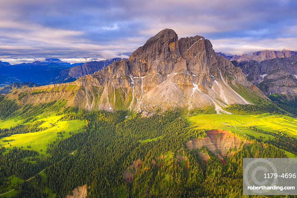 Aerial view of Sass De Putia (Peitlerkofel) and canyon surrounded by woods, Passo Delle Erbe, Dolomites, South Tyrol, Italy