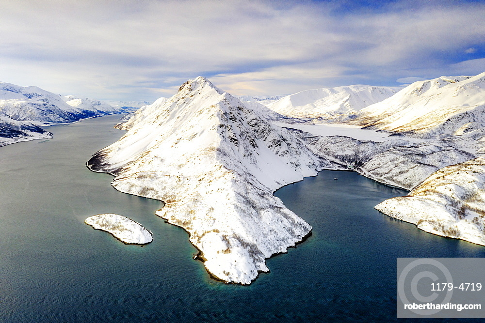 Aerial view of snow capped mountains along the clear water of Altafjord, Troms og Finnmark county, Northern Norway