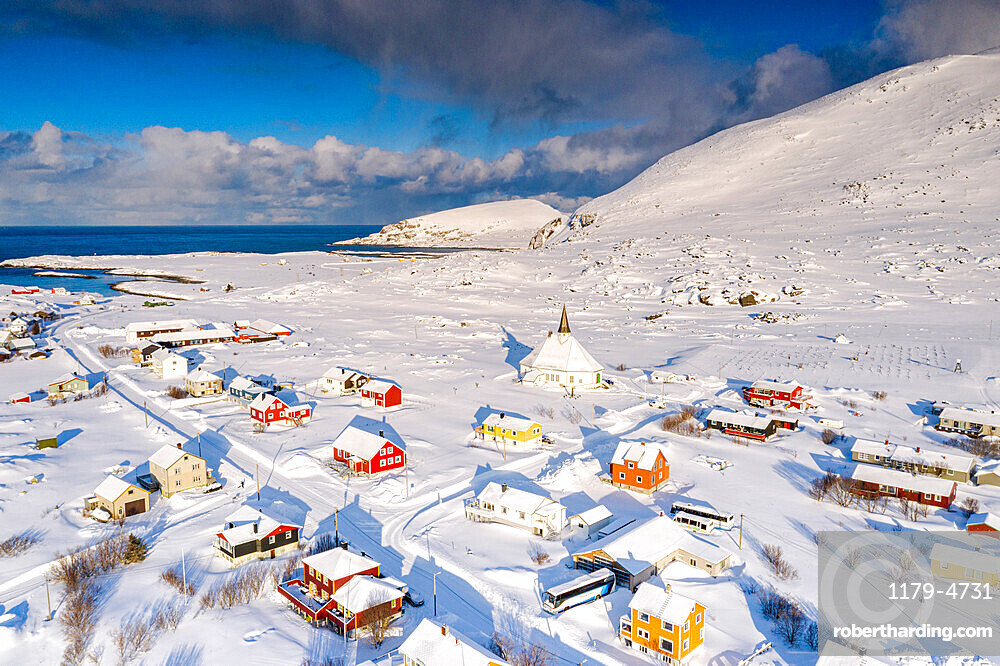 Aerial view of the fishing village of Hasvik covered with snow in winter, Soroya Island, Troms og Finnmark, Northern Norway, Scandinavia, Europe