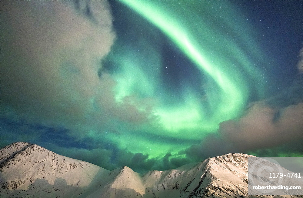 Northern Lights (Aurora Borealis) over mountain peaks covered with snow, Sorvaer, Soroya Island, Hasvik, Troms og Finnmark, Norway, Scandinavia, Europe