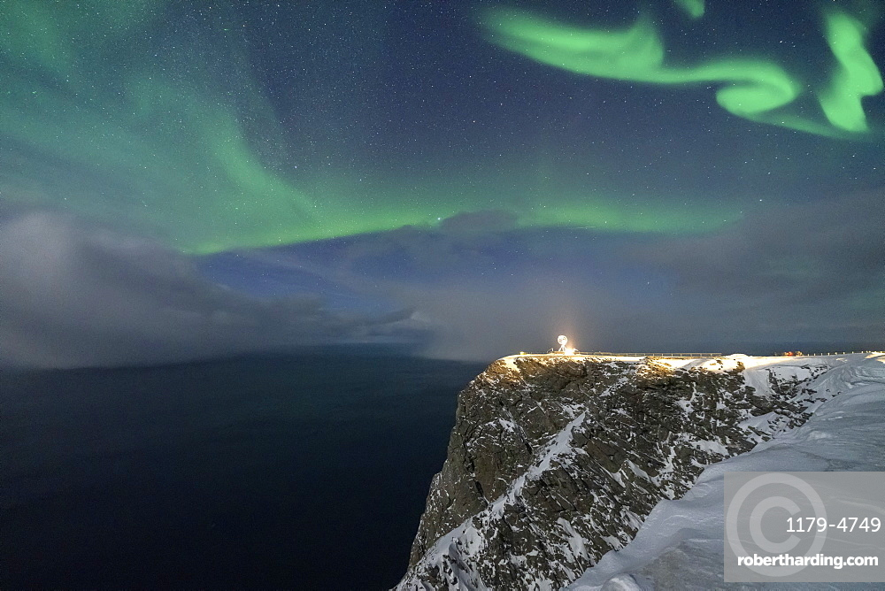 Northern Lights (Aurora Borealis) over North Cape cliff in winter, Mageroya island, Barents Sea, Troms og Finnmark, Northern Norway, Scandinavia, Europe