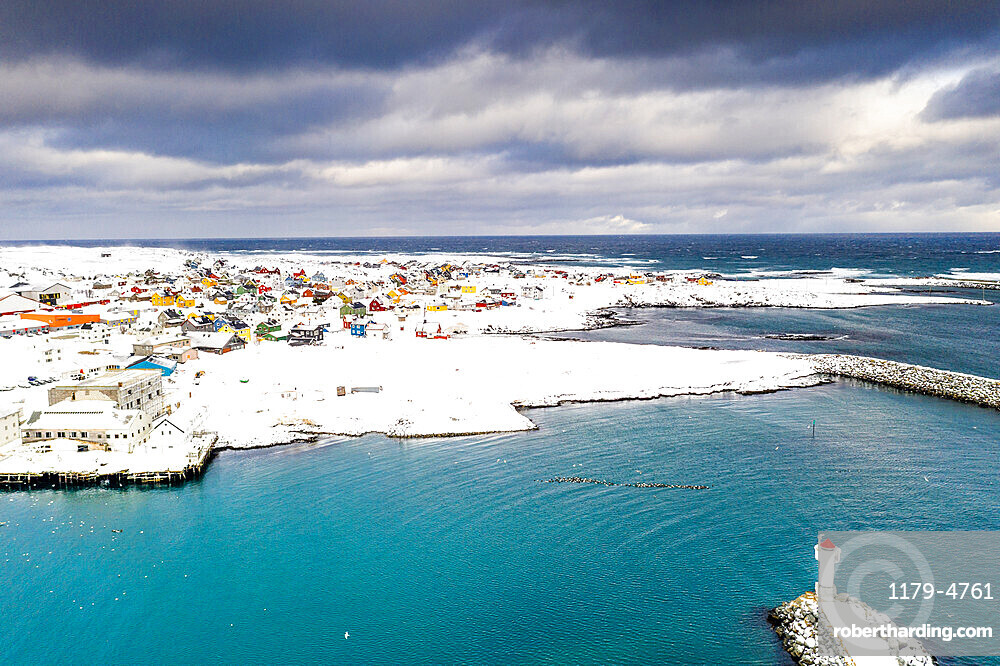 Storm clouds over lighthouse and Berlevag village covered with snow, Barents Sea, Varanger Peninsula, Troms og Finnmark, Norway, Scandinavia, Europe