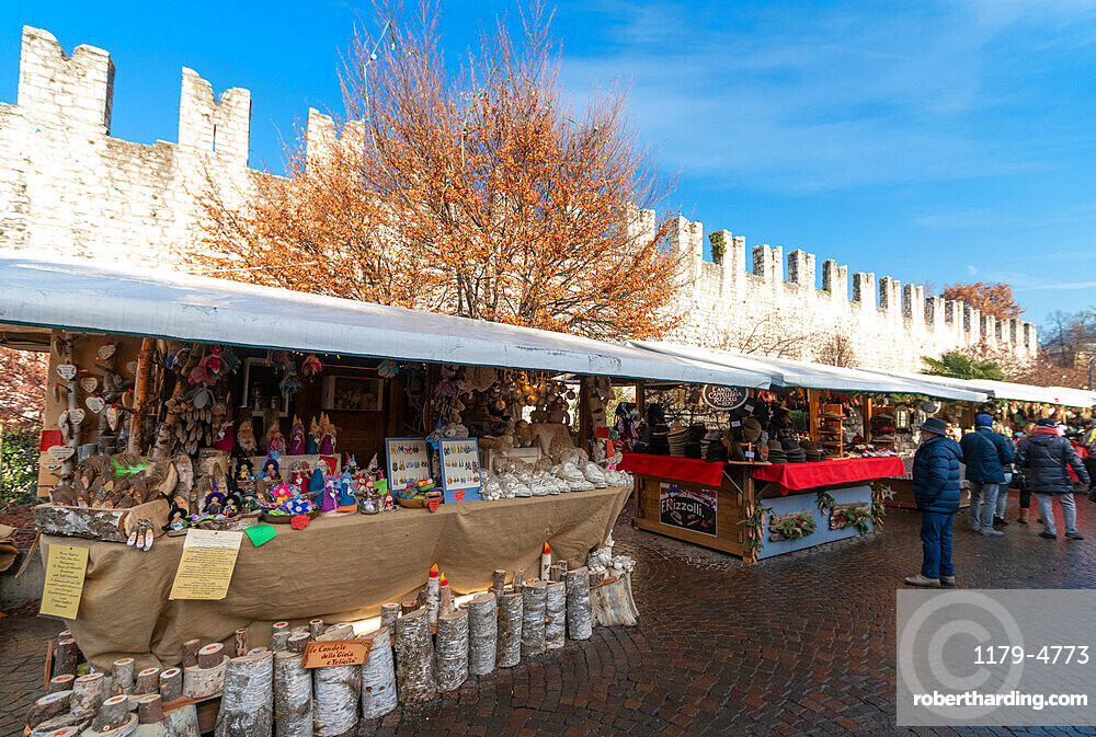 Artcraft and traditional products at the Chirstmas markets in the old town of Trento, Trentino, Italy, Europe