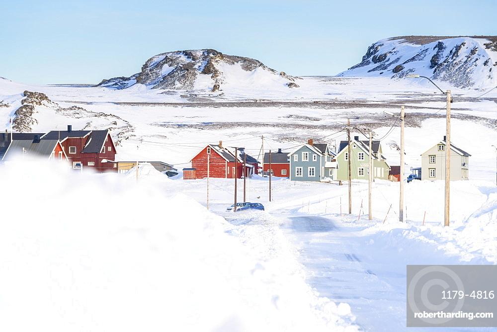 Empty snowy road to Veines village, Kongsfjord, Varanger Peninsula, Troms og Finnmark, Norway, Scandinavia, Europe