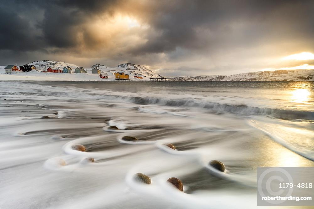 Storm clouds at dawn over waves of the Arctic icy sea, Veines, Kongsfjord, Varanger Peninsula, Troms og Finnmark, Norway, Scandinavia, Europe