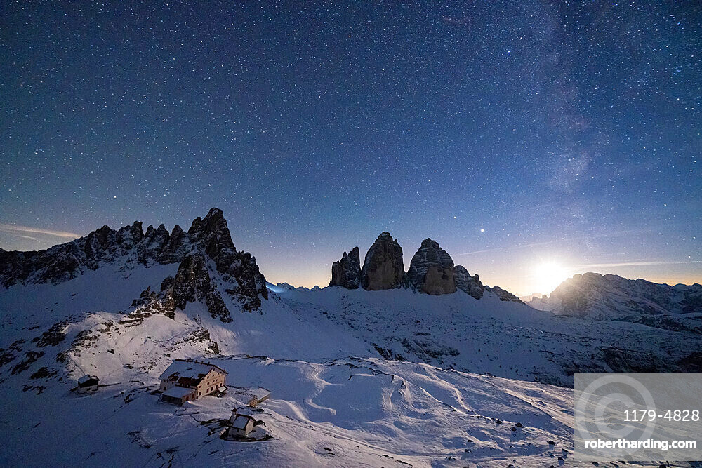 Monte Paterno, Tre Cime di Lavaredo and Rifugio Locatelli hut lit by moon, Sesto Dolomites, South Tyrol, Italy