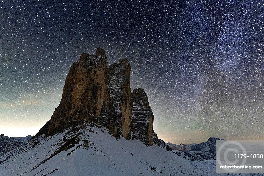 Stars in the night sky over the majestic rocks of Tre Cime di Lavaredo, Sesto Dolomites, South Tyrol, Italy