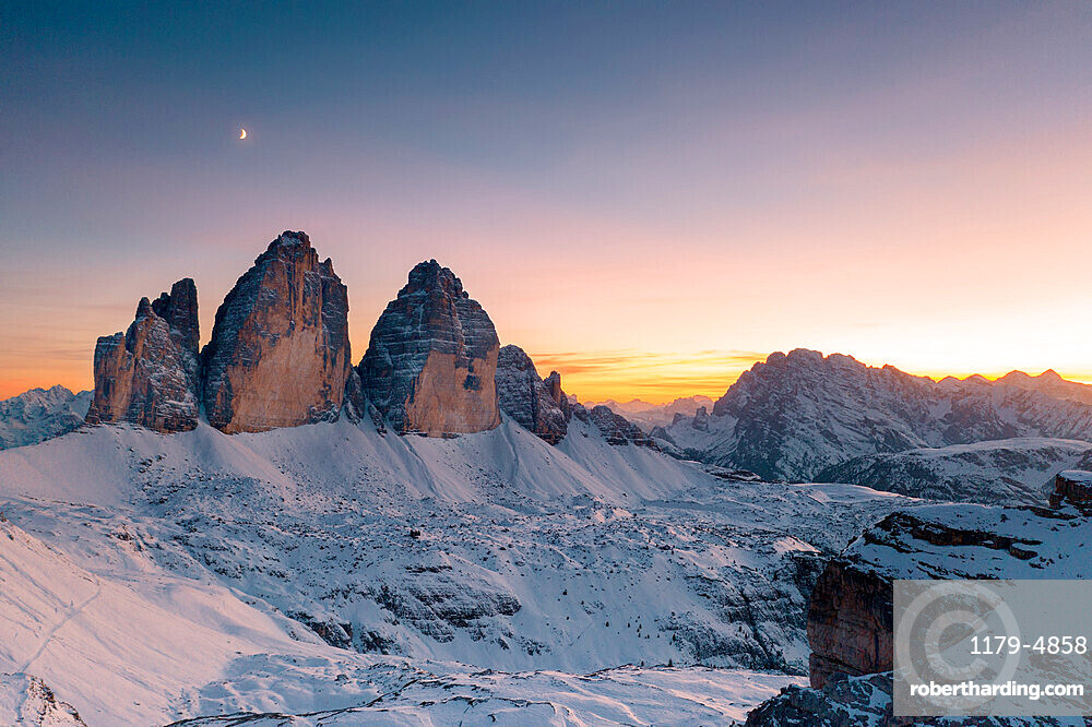 Sunset over Tre Cime di Lavaredo and Monte Cristallo covered with snow in autumn, Dolomites, South Tyrol/Veneto, Italy
