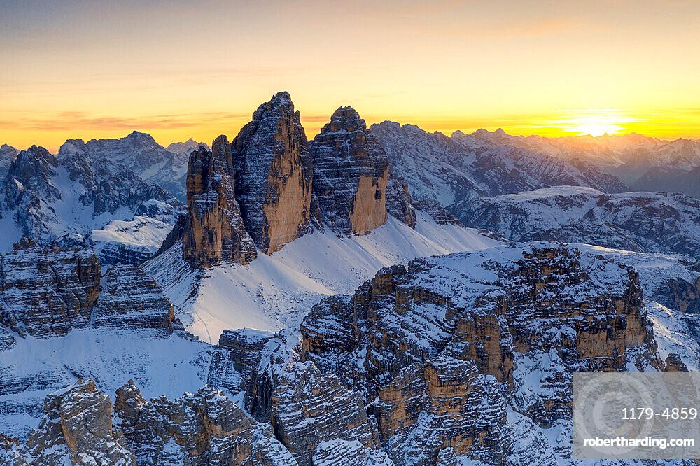 Sunset over Tre Cime Di Lavaredo, Monte Paterno and Cristallo during a snowy autumn, Sesto Dolomites, South Tyrol, Italy