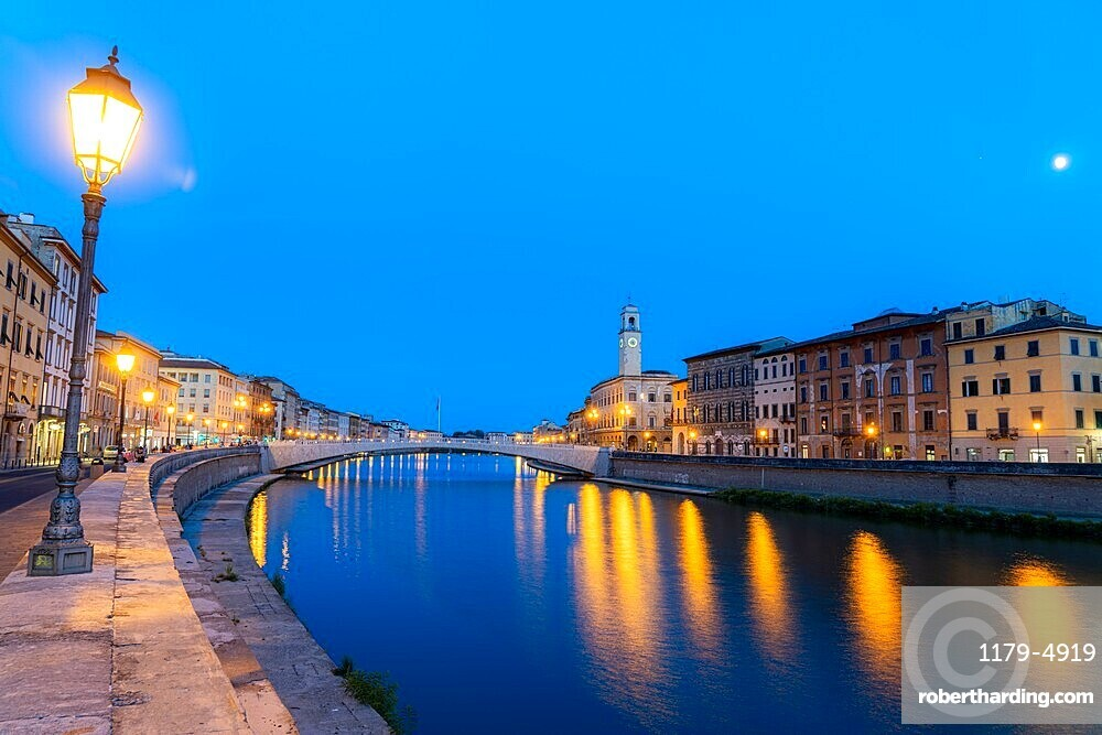Old lanterns and buildings at dusk with Ponte di Mezzo bridge on banks of Arno river (Lungarno), Pisa, Tuscany, Italy