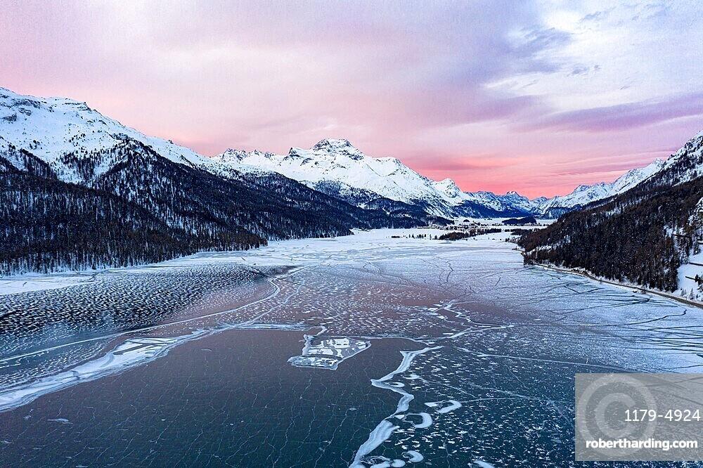 Sunrise on the snowcapped mountains and frozen Lake Silvaplana, aerial view, Maloja, Engadine, Graubunden canton, Switzerland