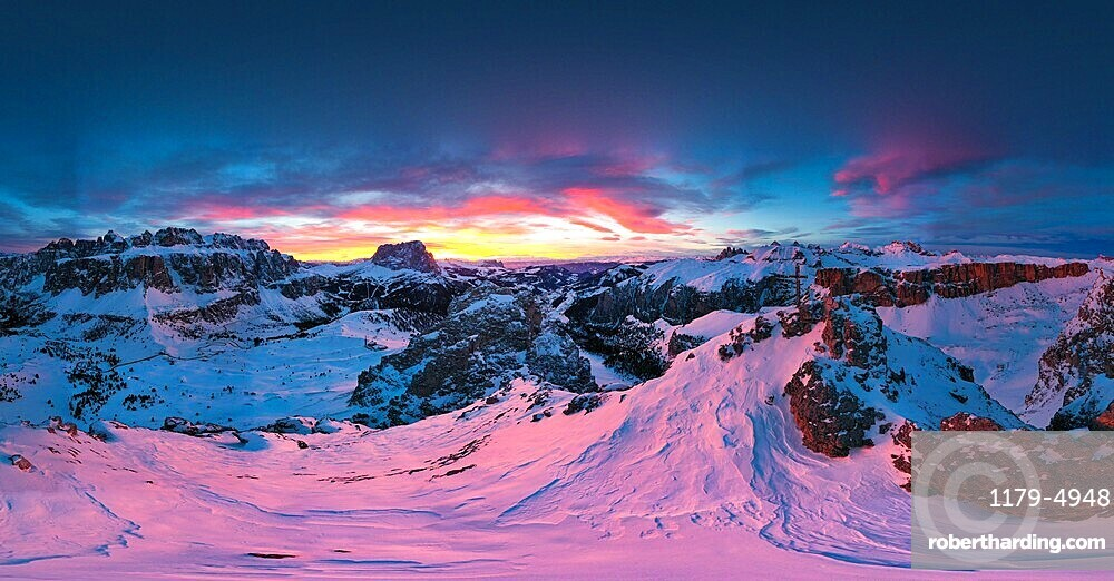 Pink sunset on the snowcapped Gran Cir, Odle, Sassolungo and Sella Group mountains in winter, Dolomites, South Tyrol, Italy