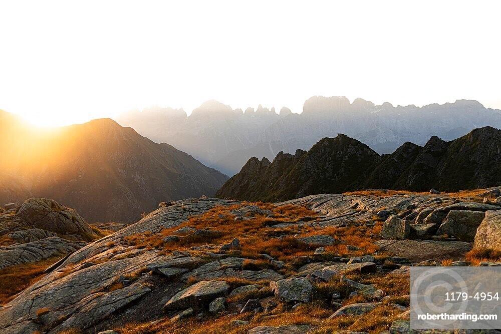 Foggy sunrise over Brenta Dolomites view from Rifugio Cornisello, Adamello Brenta Nature Park, Trentino-Alto Adige, Italy