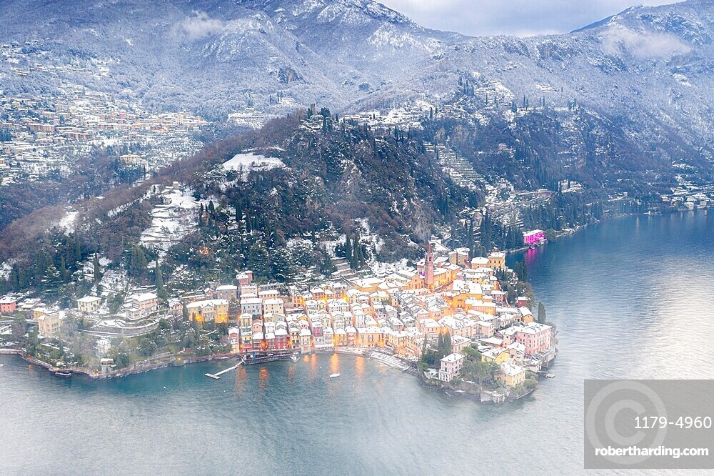 Romantic town of Varenna covered with snow, aerial view, Lake Como, Lecco province, Lombardy, Italy