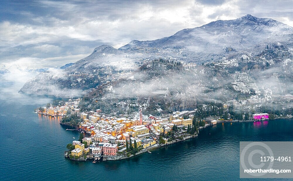Mist over Varenna old town and Lake Como after a snowfall in winter, aerial view, Lecco province, Lombardy, Italy