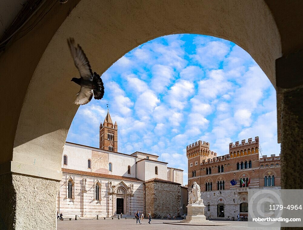 Summer sky over Canapone monument statue and Duomo, Piazza Dante, Grosseto, Tuscany, Italy