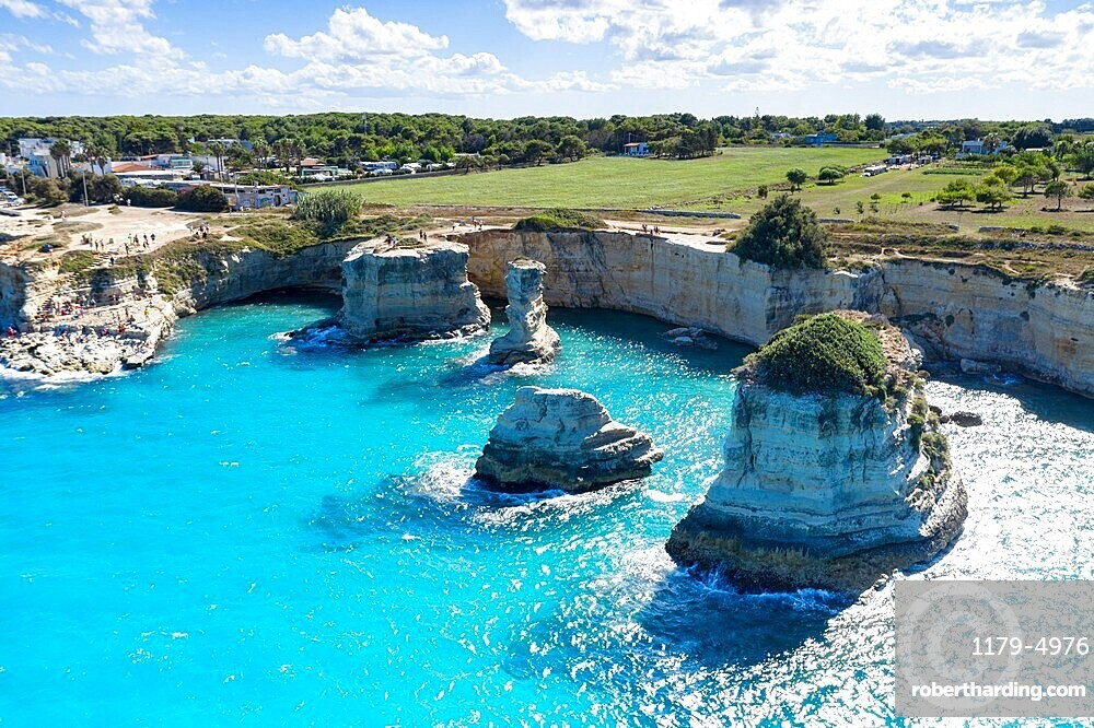 Faraglioni of Torre Sant'Andrea and cliffs framed by turquoise sea, Lecce province, Salento, Apulia, Italy, Europe