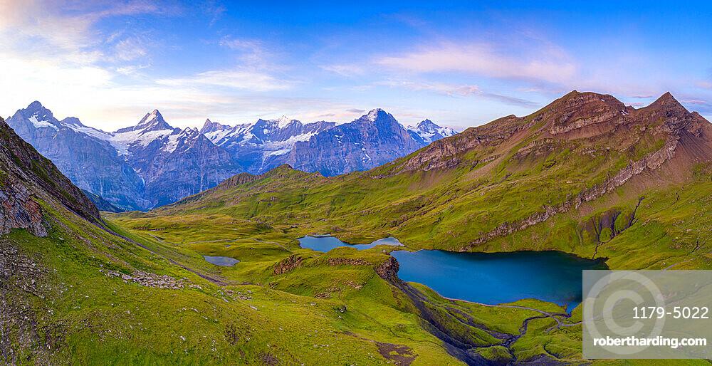 Sunrise over Wetterhorn, Schreckhorn and Finsteraarhorn from Bachalpsee lake, Grindelwald, Bernese Oberland, Switzerland, Europe