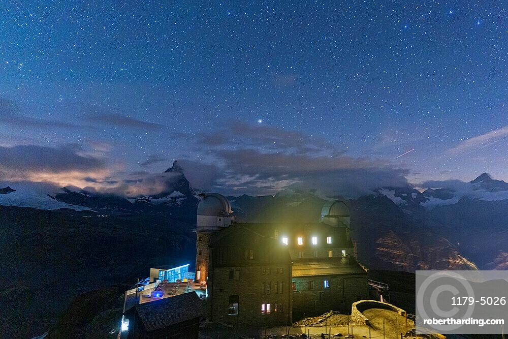 Starry sky over the Kulmhotel Gornergrat and Matterhorn, Zermatt, canton of Valais, Switzerland, Europe