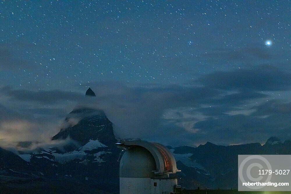 Stars over Matterhorn viewed from the observatory tower of Kulmhotel Gornergrat, Zermatt, canton of Valais, Switzerland, Europe