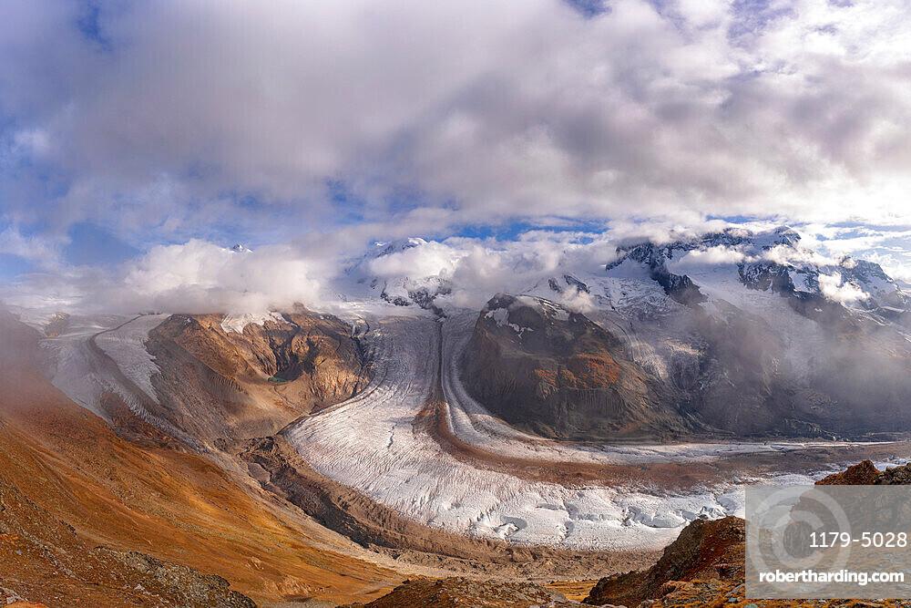 Cloudy sky over snowcapped mountains and Gorner Glacier (Gornergletscher), Zermatt, canton of Valais, Switzerland, Europe