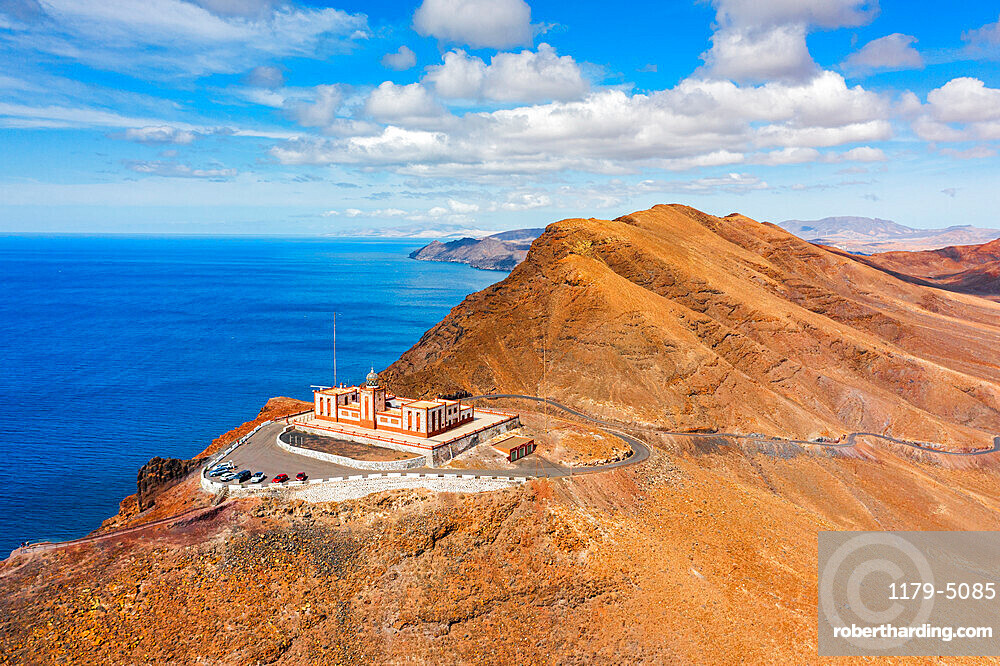 Desert mountain landscape surrounding Entallada lighthouse overlooking the ocean, Fuerteventura, Canary Islands, Spain