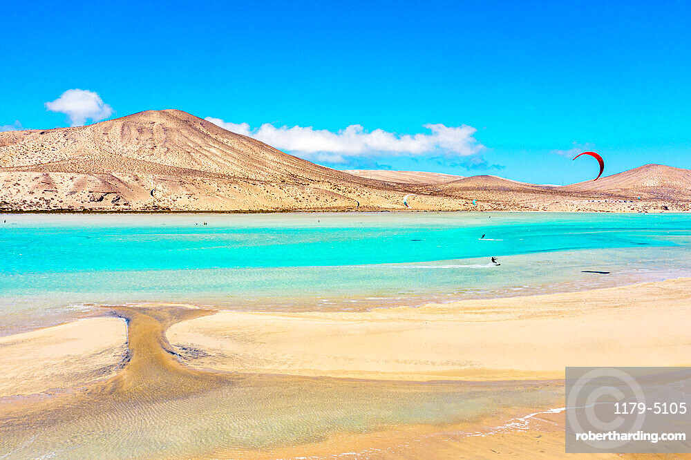 People enjoying kitesurfing at Sotavento beach (Playa de Sotavento de Jandia), Fuerteventura, Canary Islands, Spain