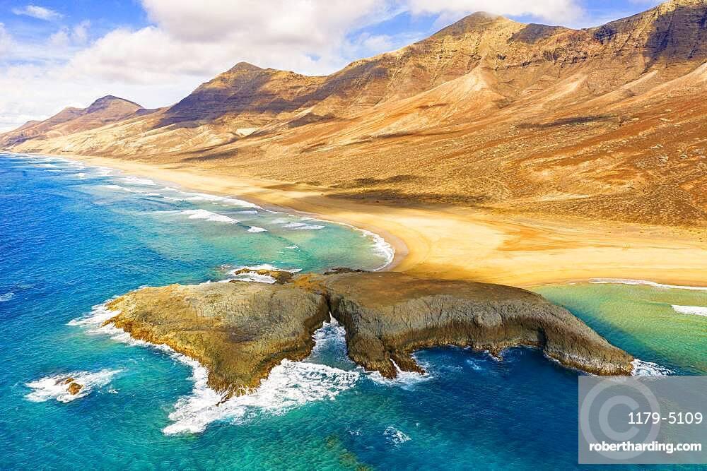 Aerial view of El Islote islet in the crystal ocean along Cofete beach, Jandia, Fuerteventura, Canary Islands, Spain, Atlantic, Europe