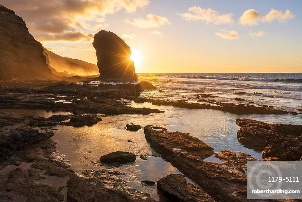 Golden sunset over the giant monolith of Roque Del Moro, Cofete beach, Jandia Nature Park, Fuerteventura, Canary Islands, Spain, Atlantic, Europe