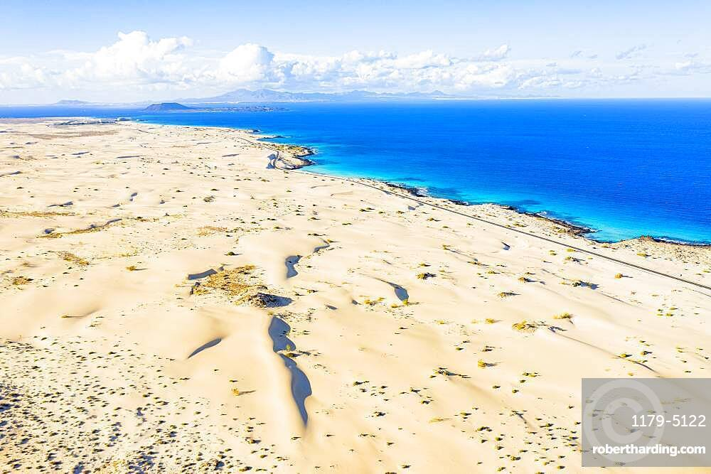 White sand dunes meeting the blue Atlantic Ocean, aerial view, Corralejo Nature Park, Fuerteventura, Canary Islands, Spain