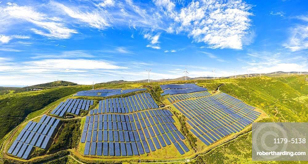 Solar panels and wind turbines in the green plateau, Encumeada, Madeira island, Portugal