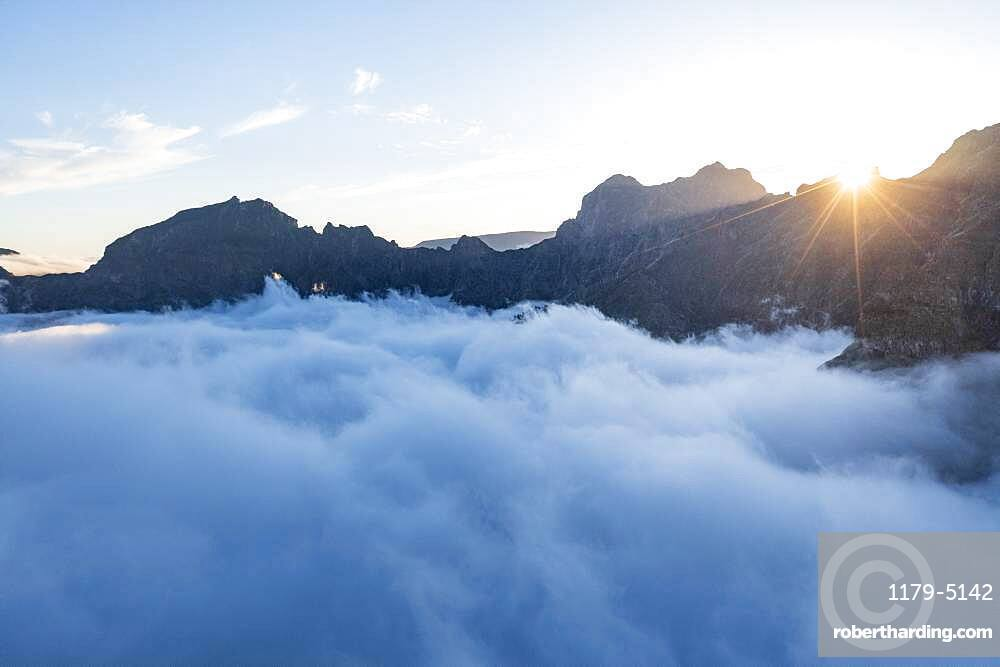 Mountains in a sea of clouds at sunset view from Pico Ruivo, Madeira, Portugal