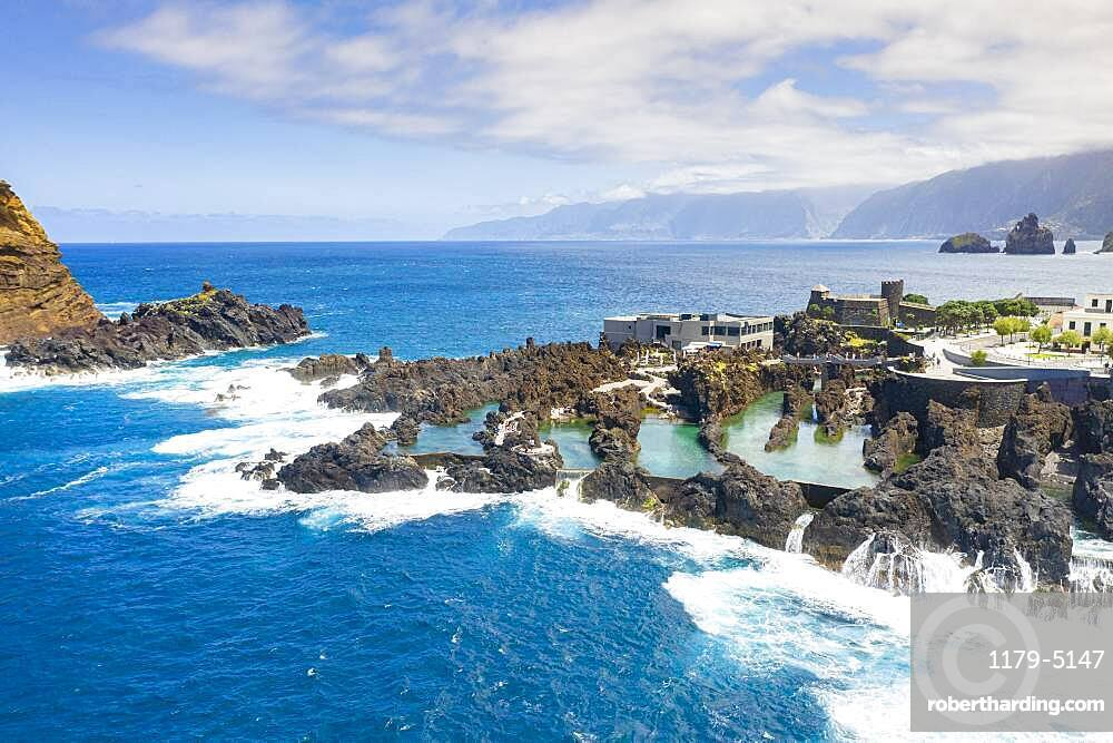Natural pools formed by volcanic lava filled with crystal-clear sea water, Porto Moniz, Madeira island, Portugal, Atlantic, Europe