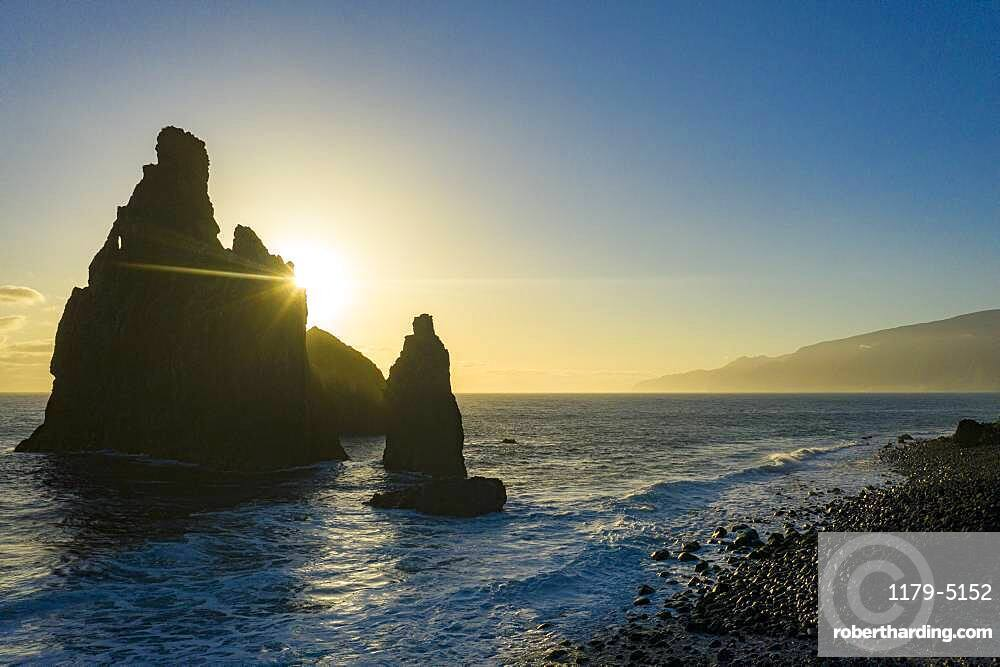 Ilheus da Rib and Ribeira da Janela rock formations lit by sun rays at dawn, Atlantic Ocean, Porto Moniz, Madeira, Portugal, Atlantic, Europe