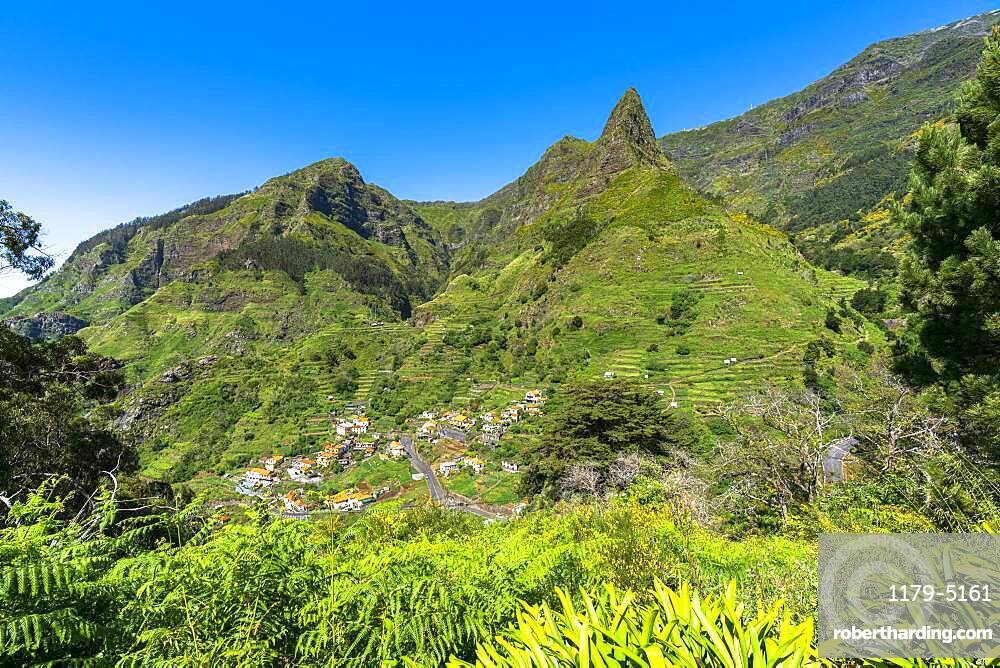 Village of Serra de Agua in the lush vegetation at feet of mountains, Ribeira Brava municipality, Madeira island, Portugal, Atlantic, Europe