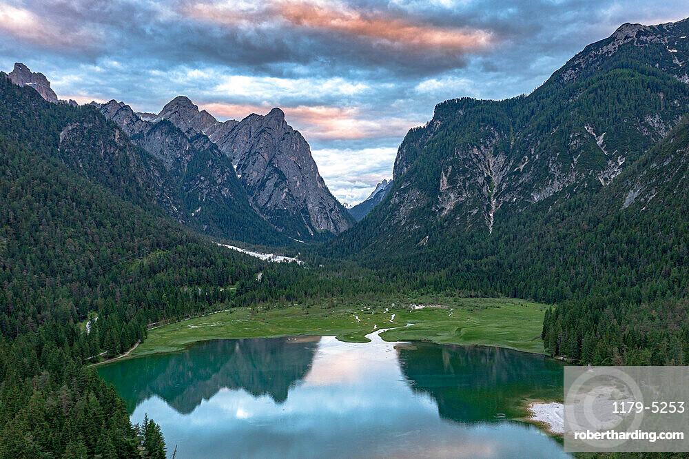 Aerial view of mountains reflected in lake Dobbiaco at sunset, Dobbiaco/Toblach, Dolomites, Bolzano province, South Tyrol, Italy