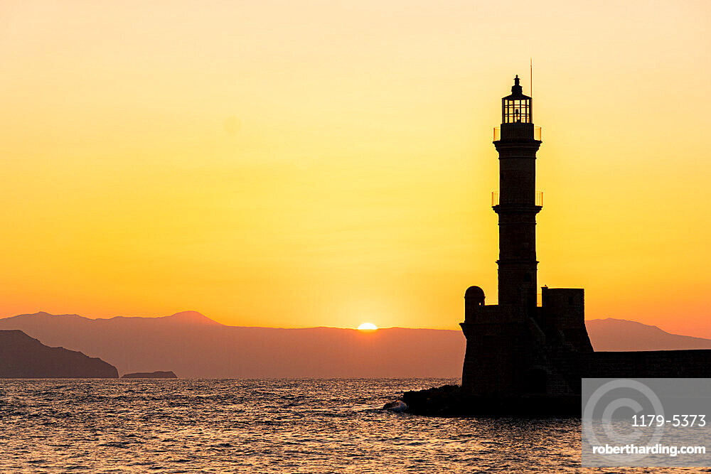Silhouette of the old lighthouse at sunset, Chania, Crete, Greece