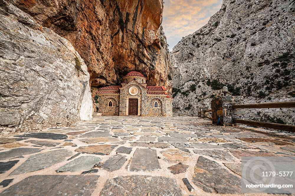 Orthodox chapel Agios Nikolaos nestled in rocks in Kotsifou canyon, Crete island, Greece