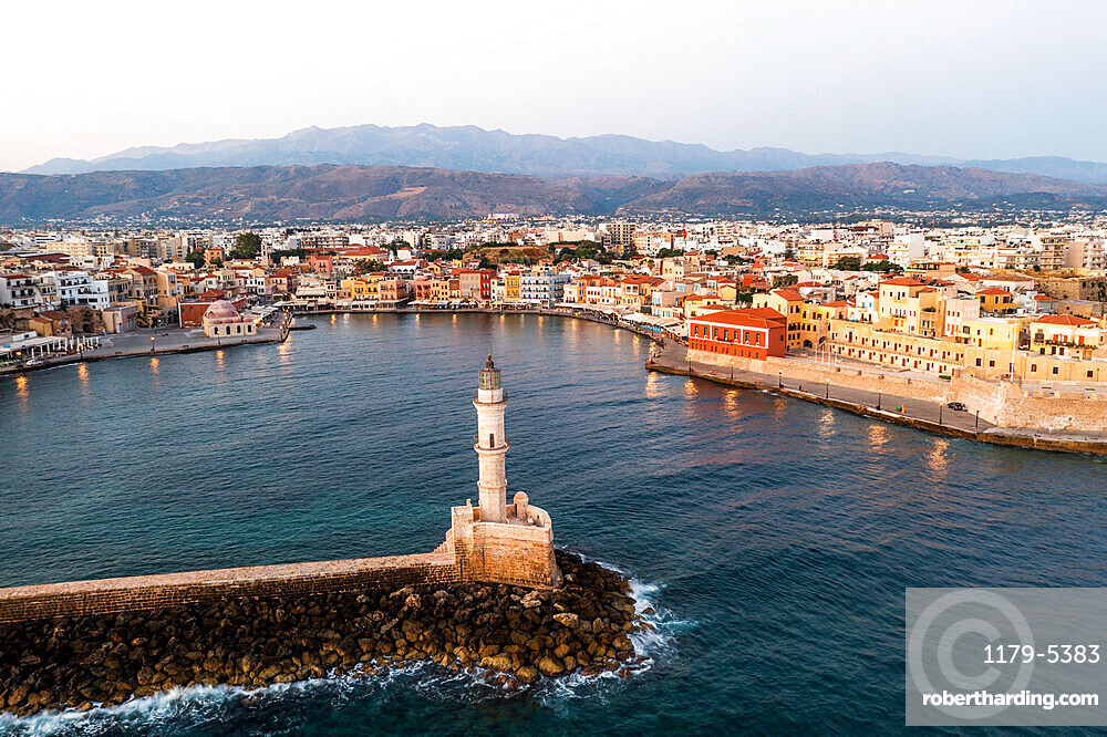 Sunrise over the Venetian lighthouse and harbour in the colorful town of Chania, aerial view, Crete, Greece