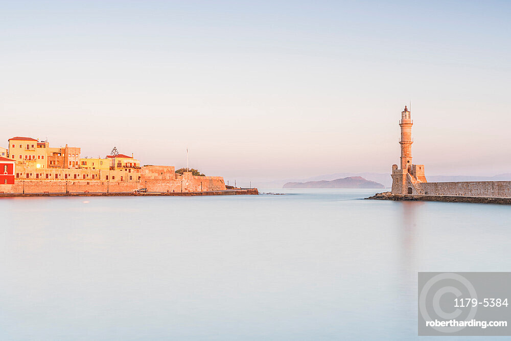 Romantic sky at dawn over the old fortress and lighthouse, Chania, Crete, Greece