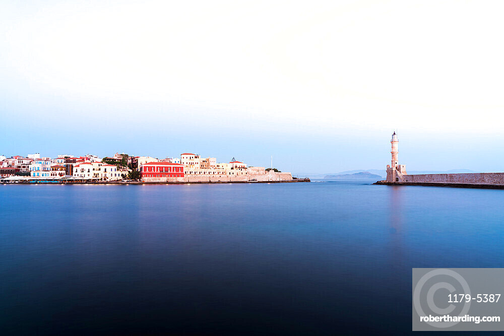 Dusk over the Venetian lighthouse and harbour of Chania old town, Crete, Greece